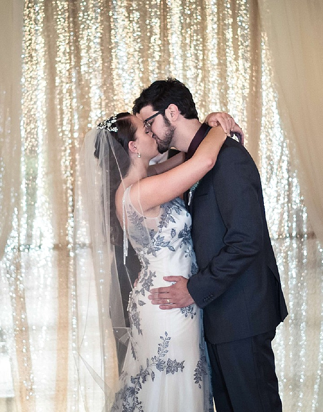 Sweet snap of the first kiss as Mr. and Mrs!