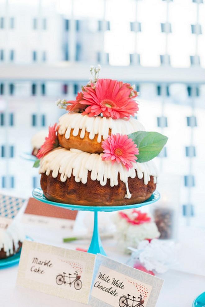 We love this couple's Nothing Bundt Cake wedding cake dessert bar!