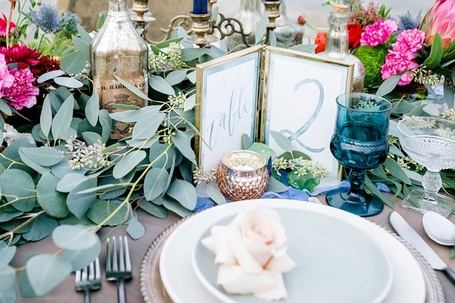 How dreamy is this table and table numbers at this styled beach wedding!