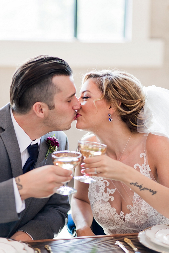 Champagne and kisses for this Mr. and Mrs. at their stunning styled wedding!