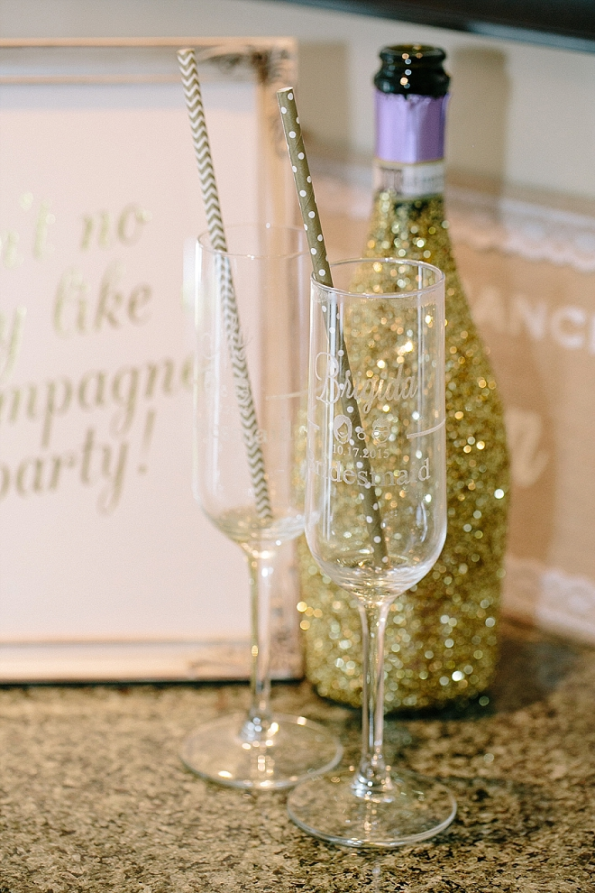 Check out these adorable etched champagne glasses and glitter bottles the bride made for her big day!