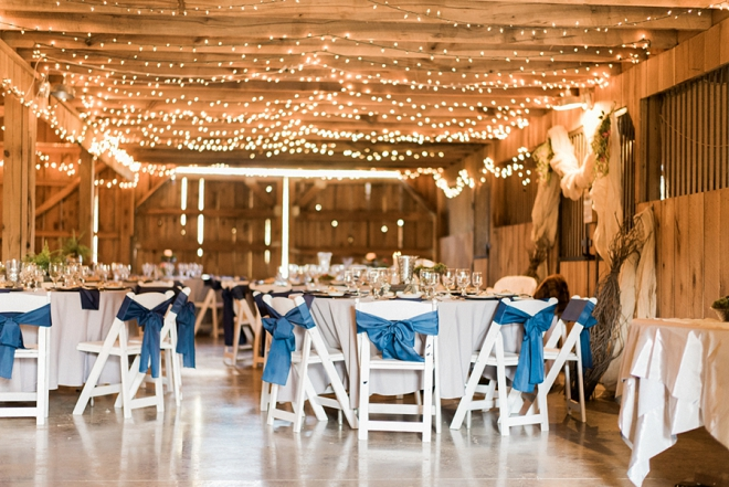 Love the navy and pops of gold and green at this couple's twinkle lit reception!