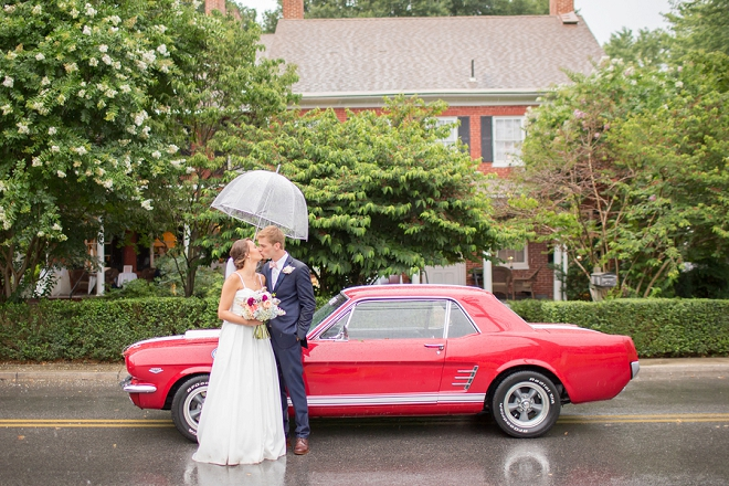 We're crushing on this snap of this darling couple and their rainy day wedding!