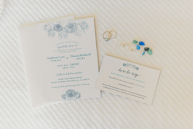 We're in LOVE with this couple's beautiful blue and white invitation suite!