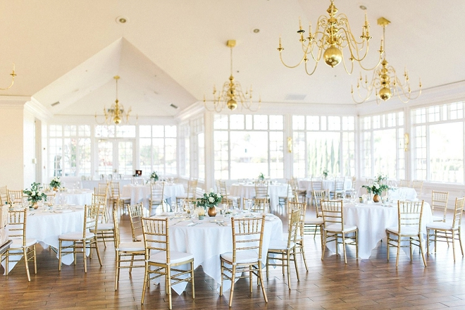 We love this reception with this delicate gold and greenery style!