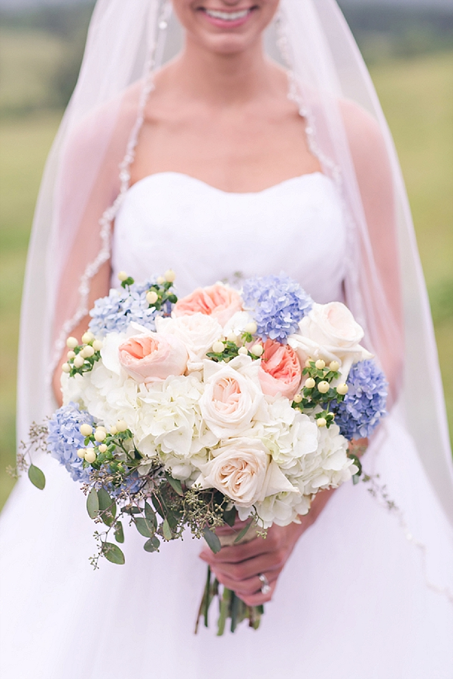 Loving this bright and springy handmade bouquet at this southern wedding!