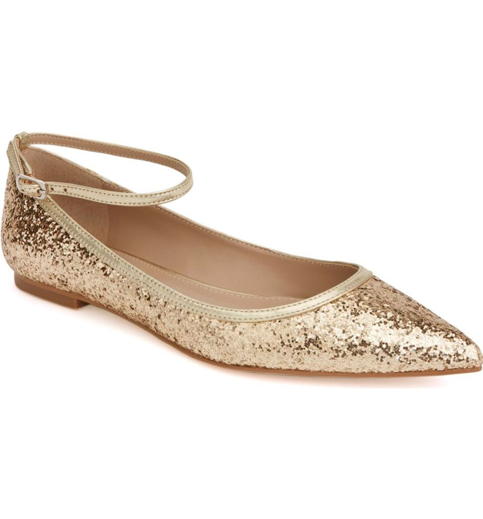 Glittery gold sparkle flats with an ankle strap. So cute!