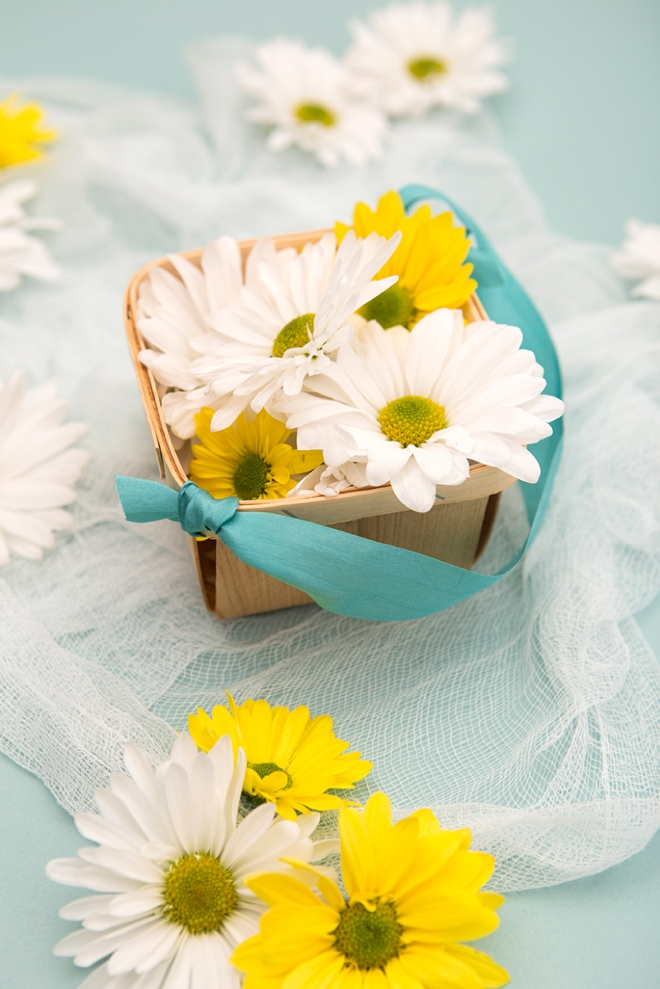 Have your flower girl toss daisy heads instead of petals!