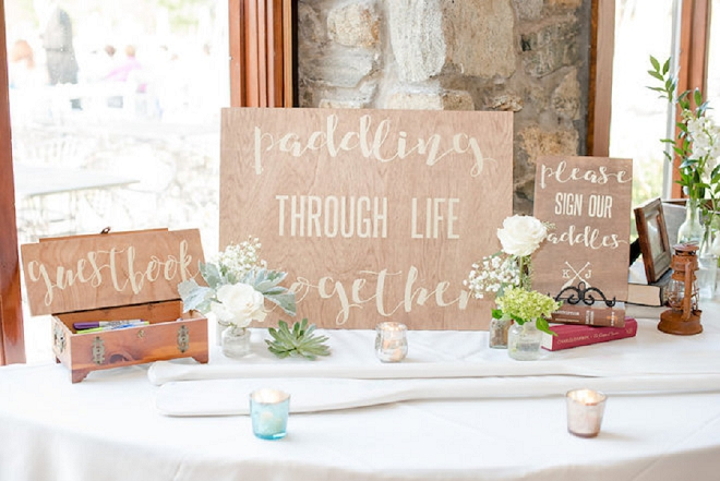 We're LOVING this couple's unique paddle guest book!