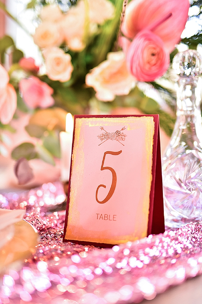 Such a gorgeous pink and gold table setting at this styled shoot!