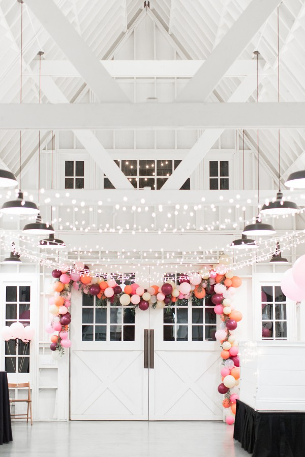 This balloon arch is so gorgeous! Soft pastels and jewel tone colors.