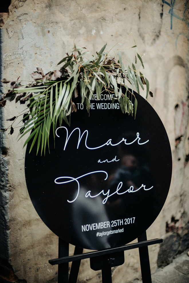 A sleek black welcome sign makes a statement.