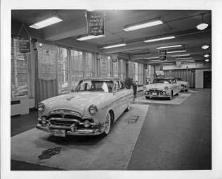 Packards in showroom circa 1950s