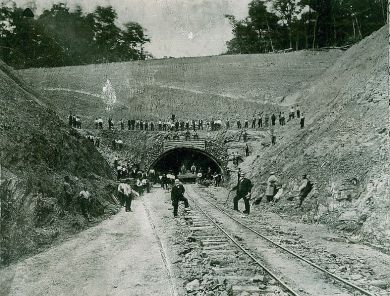 Carnegie stands in front of South Pennsylvania Railroad Tunnel, 1884