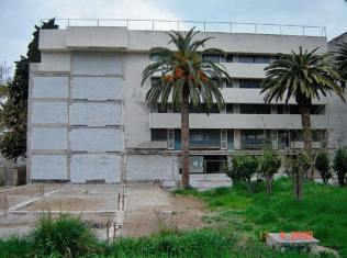 Patching the Grand Hotel on Lopud after the 2nd wing was demolished (circa 2008)