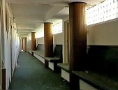 A Grand Hotel hallway before the floors were gutted. Today the benches and columns are still present, but many of the rooms are gone.
