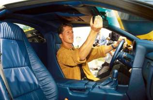 F1 champion Michael Schumacher is careful to adjust his rear view mirror, because that is the only place he will see other cars.