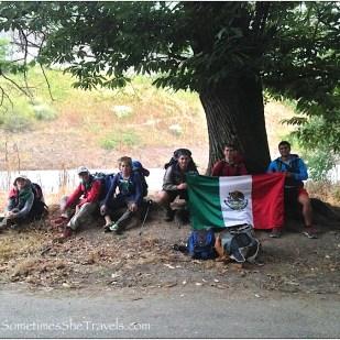 teenage boys holding mexican flag