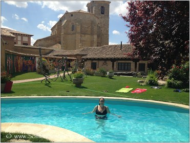 woman in swimming pool with church in background