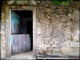 blue door in stone wall