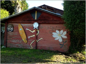 red wall with surfboard and painted flower