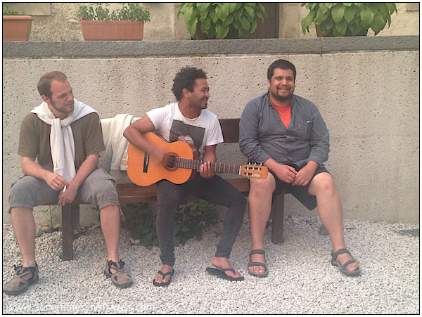 Day 2: Jan , Al, and Benjamin providing the pilgrims with music in the courtyard at Roncesvalles.