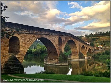 ancient stone bridge over river