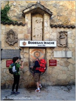 Backpackers at wine fountain in Spain