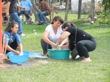 Fiesta Patronal 2014; the next time you complain about doing dishes (and especially if you have a dishwasher!) please remember this photo of my senoras doing dishes in laundry tubs on the ground. For 100 people.