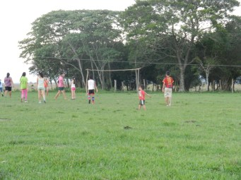 Notice the little tyke right of center during evening girls' futbol practice. Kids and young boys play with girls until they are old/strong enough to play with the teens and young men.