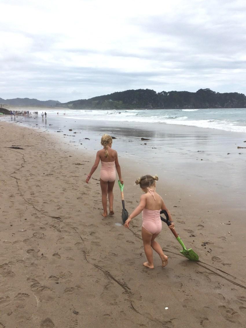 girls walking with spades
