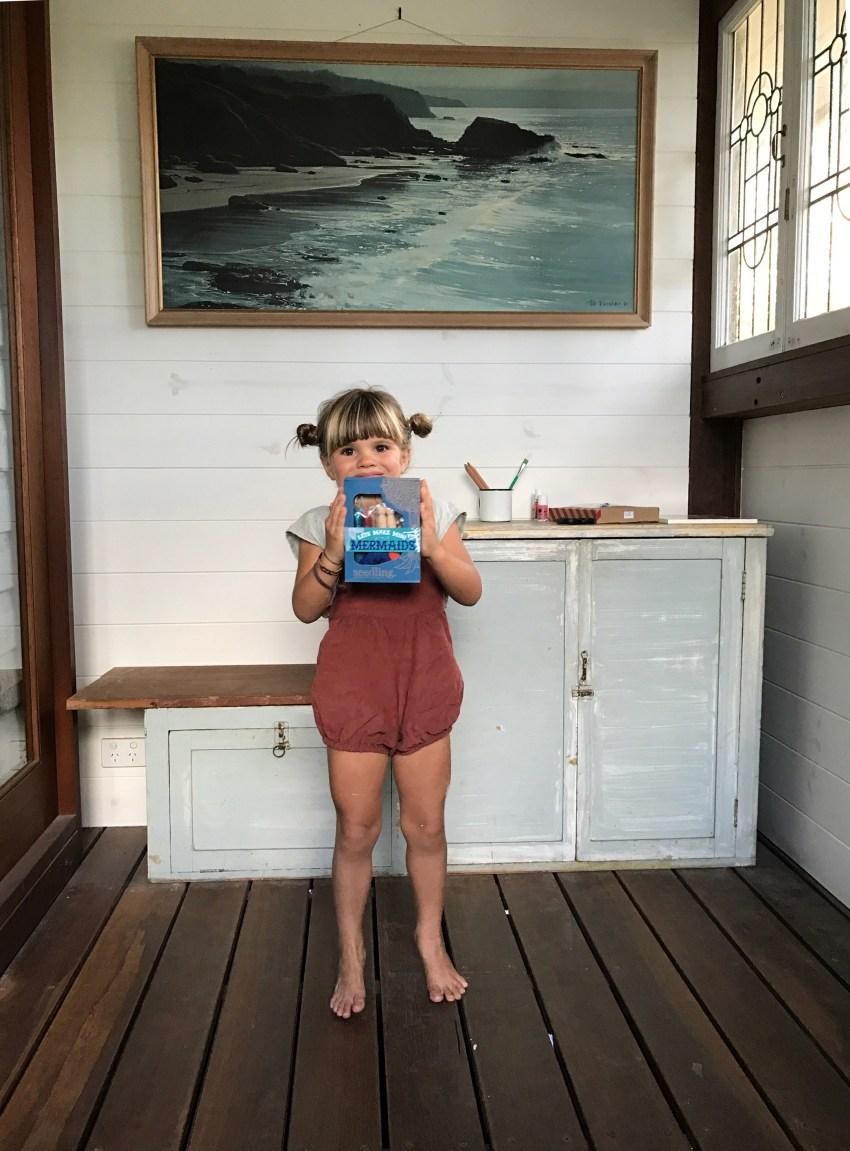 mermaids_marlow-holding-package