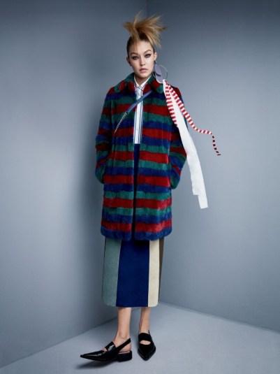 Gucci coat. Miu Miu shirt. Derek Lam skirt. Miu Miu earrings. Dior Bag.