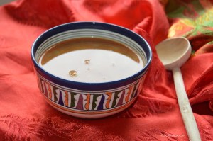 Moroccan Bowl of harira soup with traditional moroccan wooden spoon, a classical moroccan food