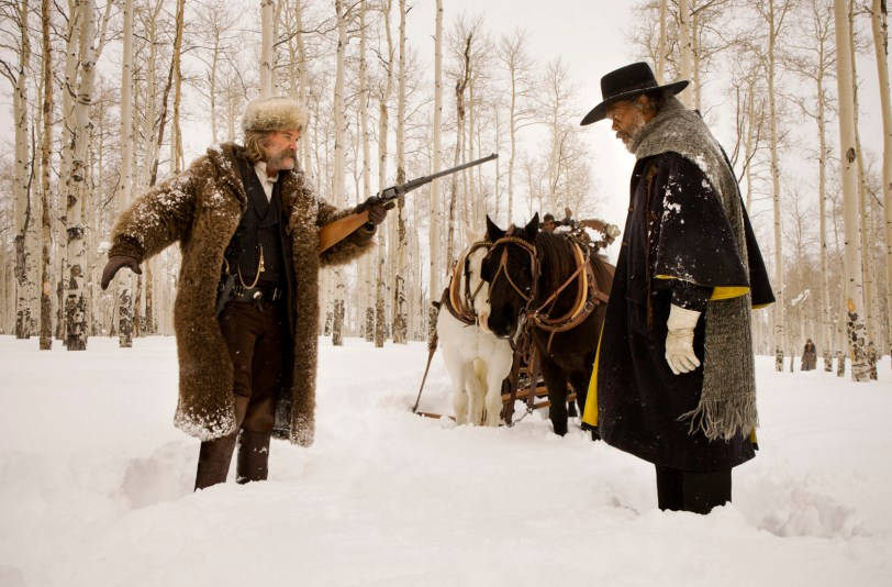 (L-R) KURT RUSSELL and SAMUEL L. JACKSON star in THE HATEFUL EIGHT. Photo: Andrew Cooper, SMPSP © 2015 The Weinstein Company. All Rights Reserved.