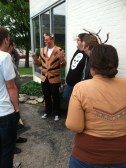 """Cat Chadourne preps the Tiger Style performers, including Sam """"For Real Doe"""" Rager."""