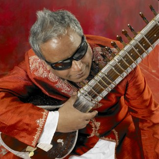 BALUJI IN RED WITH SITAR