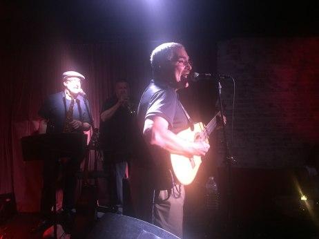 JuanMa-playing-cuatro-spotlights-sax-palyer-singing-Subrosa-Blue-Note-Group-Highline-ballroom-club-NYC