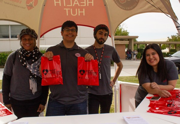 Members of the Student Health and Wellness Advisory Commitee pose inside the Health Hut during the Renegade Pulse Health Fair on April 18th.