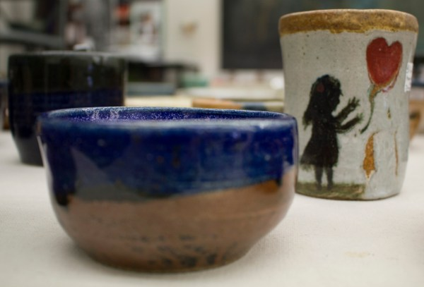 ceramic bowl and cup with girl and heart motif