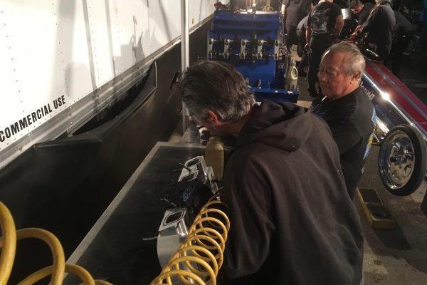 Mechanics working on engine