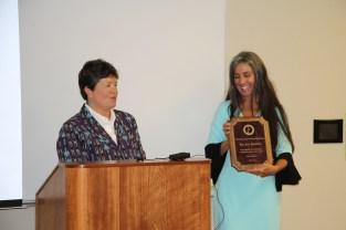 Susan presenting a plaque to Rae Ann