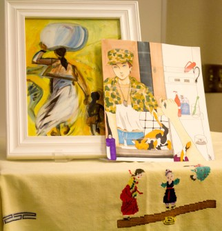 """Gita Lloyd's cover for Portia Choi's poetry book """"Sungsook"""" is displayed in the Levan Center next to a drawing by BC student Crystal Appleton."""