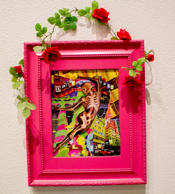 Collage of colorful images as a backdrop to a skeleton framed in bright pink with a rose vine hanger.