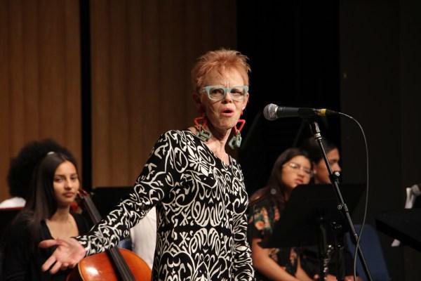 Woman with interesting fashion sense singing