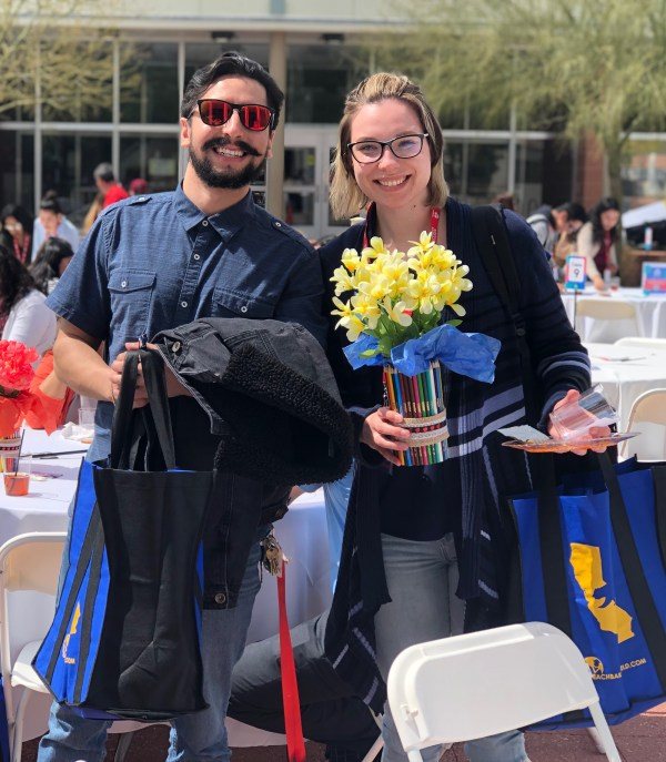 Man with hipster beard and woman holding flowers
