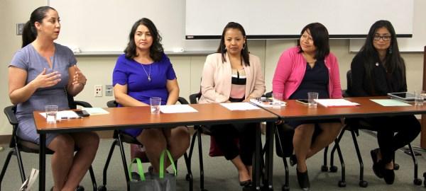 Five women sitting on a panel