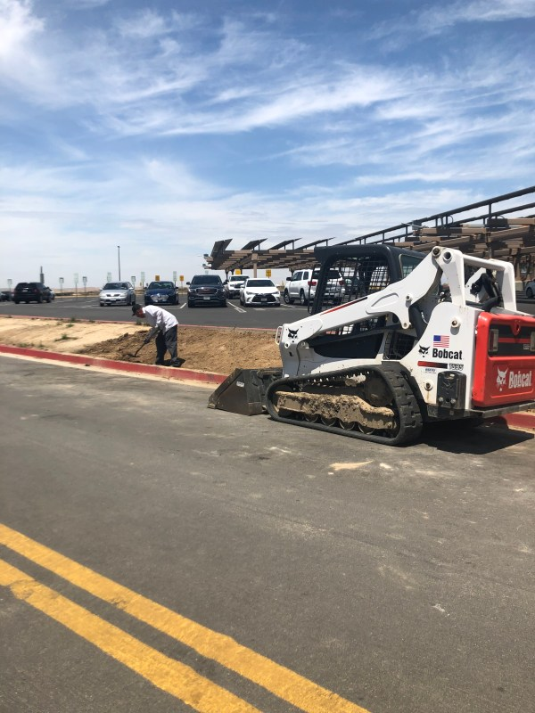 Preparing for installation of artificial turf at the solar parking lot.