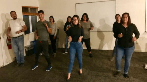 Students line dancing.