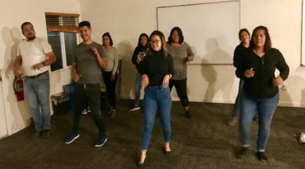 Students line dancing.